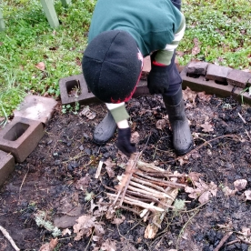 The log cabin method as demonstrated by one of the boys.